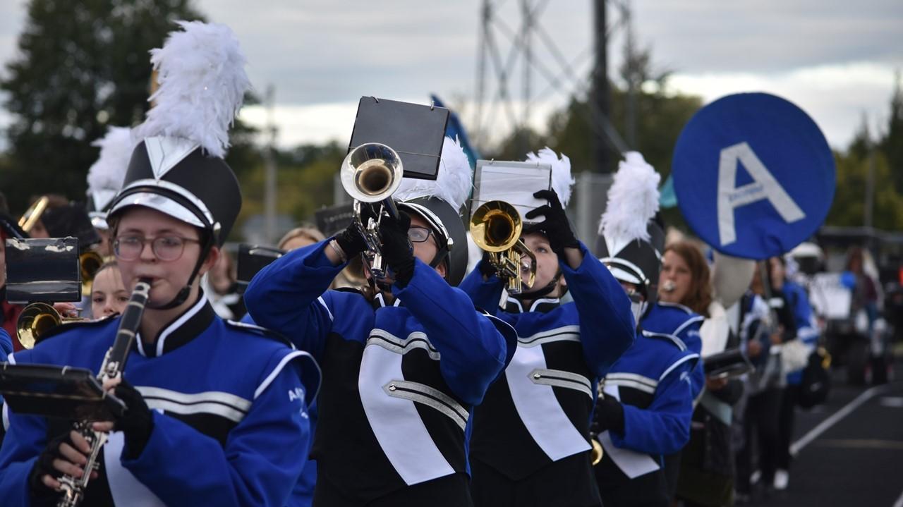 band leading the homecoming spirit parade