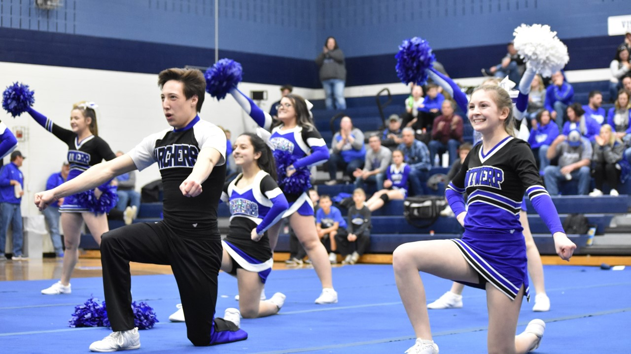 The competition cheer squad performs their state-qualifying routine.