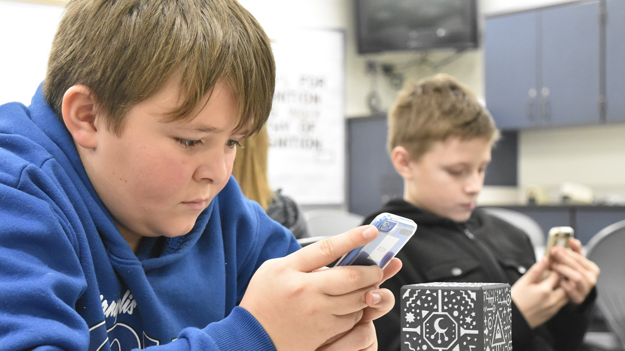 Fifth grade students experiment with augmented reality with MERGE Cubes.