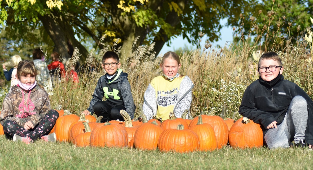 third graders with pumpkins on Prairie Garden Day