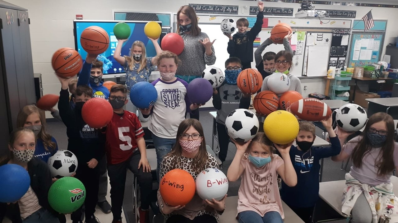 elementary student council with playground balls purchased with hat day money